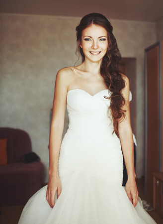 marriageable: young caucasian bride getting ready at home