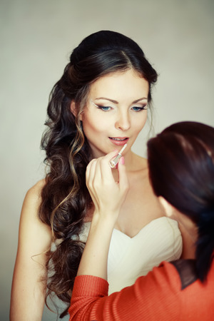marriageable: Bride having make up, getting ready at home.