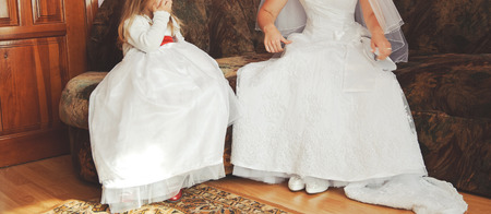 litle: Bride and litle bride maid is getting ready in the morning. Stock Photo