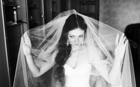 marriageable: Beautiful bride is getting ready in the morning.