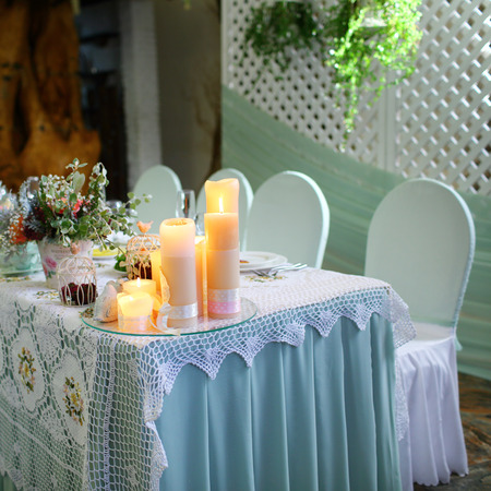 ceiling plate: Wedding banquet table in a restaurant.