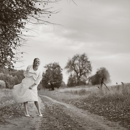 happy wedding: Portrait of beautiful bride wearing wedding dress in countryside.