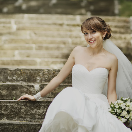 marriageable: Young happy bride outside on wedding day. Stock Photo
