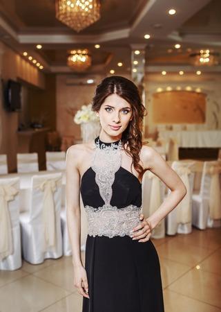 fancy dress party: Teenage girl wearing fancy prom dress, posing on  school-leaving party.