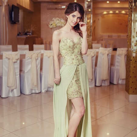 prom dress: Teenage girl wearing fancy prom dress, posing on  school-leaving party.