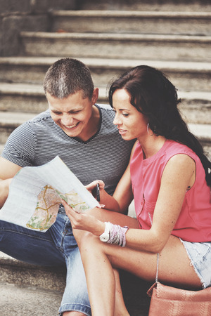 hetero: Young couple travel Europe together at summertime.