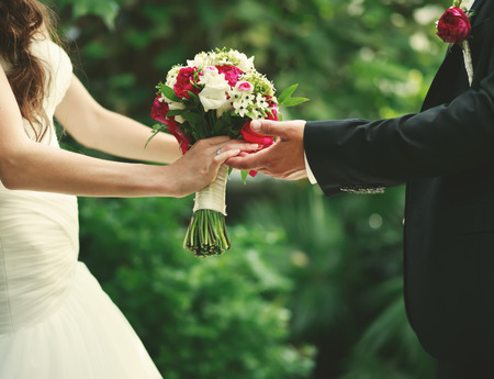 outdoor wedding: Wedding couple holding hands, groom and bride together on wedding day. Stock Photo