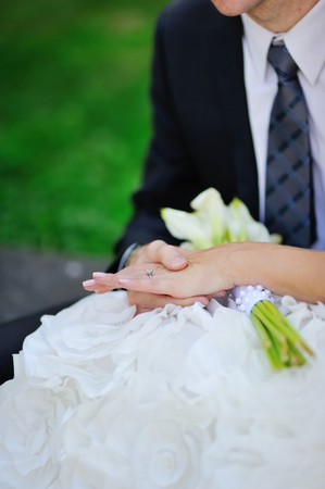 caucasion: young caucasion groom and bride. holding wedding bouquet Stock Photo