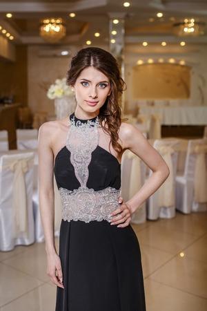 fancy girl: Teenage girl wearing fancy prom dress, posing on  school-leaving party.