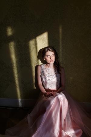 fancy girl: Teenage girl wearing fancy prom pink dress, posing on  school-leaving party. Stock Photo