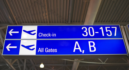 travel features: Airport Signs showing the directions to the gates at the Athens International Airport.