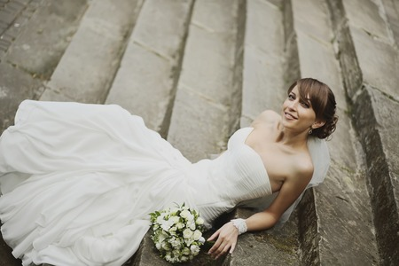 marriageable: Young happy bride jumping. Summertime picture.