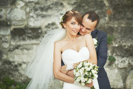 newlywed couple: portrait of  young wedding couple Stock Photo