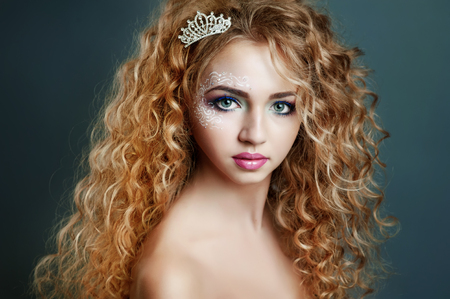 prom queen: Perfect skin. Curly teen girl with little crown. Prom queen. Stock Photo