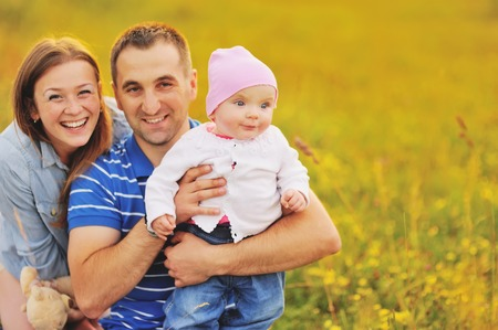 happy family concept: Mother father and lovely daughter. Summertime. Happy family concept. Stock Photo