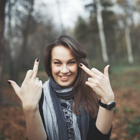 quiting: Middle finger of young woman. Female giving a finger Stock Photo