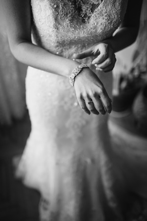 fiance: Happy bridal morning. Fiance getting ready. Wedding picture in black and white.