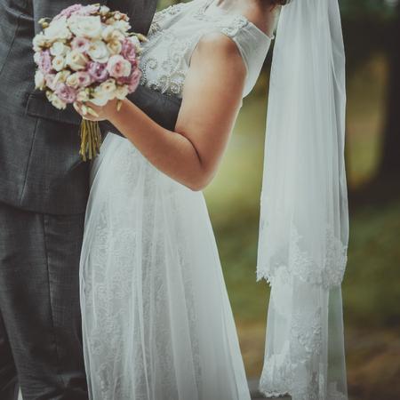 Happy bride and groom together. Summer wedding photo.