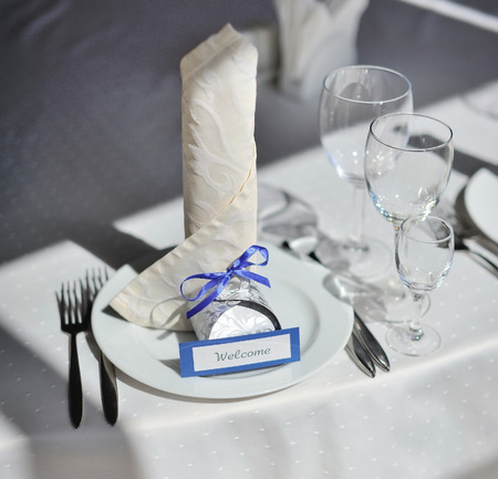 roomy: Served table with dishes and glasses