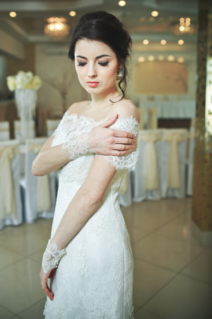 happy wedding: Young bride wering slim gorgeous wedding dress.