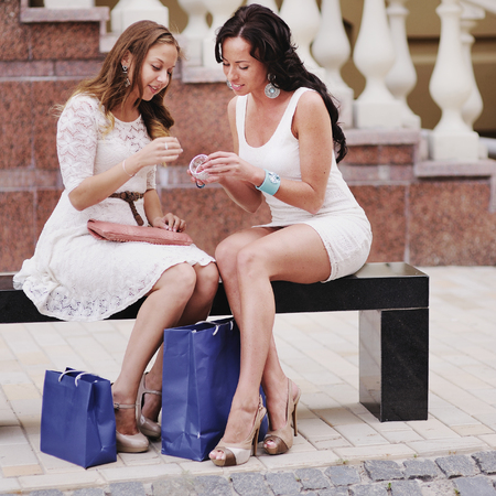 after shopping: Happy women after shopping chat. Stock Photo