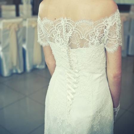 Young bride wering slim gorgeous wedding dress.