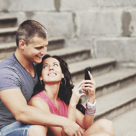 selfy: Young couple travel Europe together at summertime.