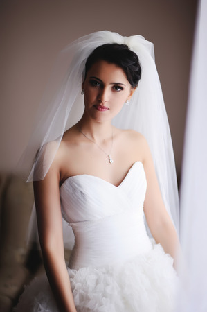 marriageable: Beautiful young caucasian bride at home.