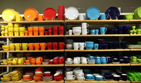 vitrine: colourful crockery. vitrine with great assortment Stock Photo