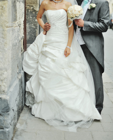 newlywed couple: Newlywed couple on the street. Happy together Stock Photo
