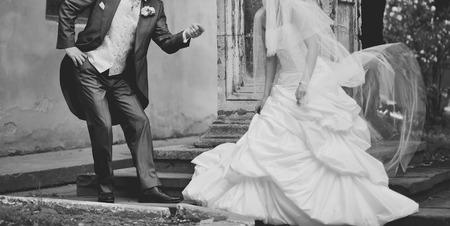 coupled: Newlywed coupled having fun. Wedding day
