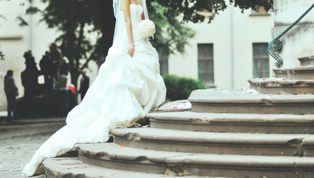 Young caucasian bride outside,