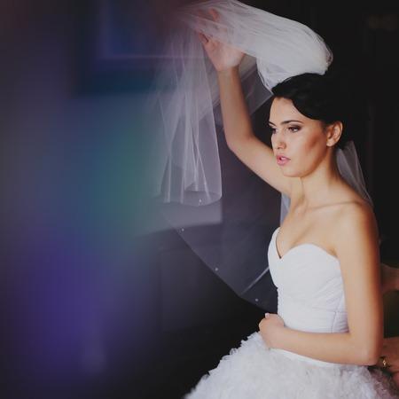getting a bride: Beautiful bride in wedding dress getting ready for wedding