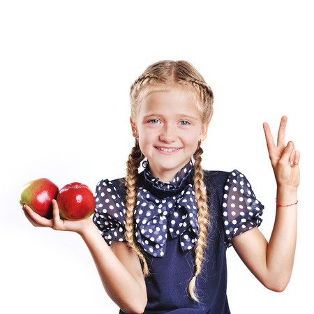 plaits: School kid with plaits holding apple at white background.