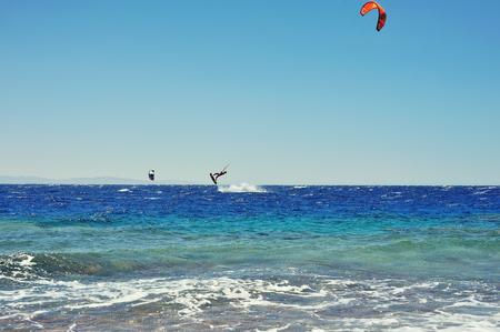 kiteboarding: riding on kite surf board on Red Sea, Dahab