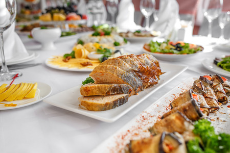 Banquet Table in restaurant served with different meals. Ready for wedding reception. Stock Photo
