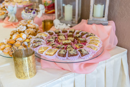 Sweet desserts with cream, berries and pastry on wedding banquet table.