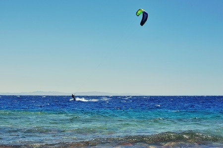 wind surfing: feel of freedom, riding on kite surf board on Red Sea, Dahab