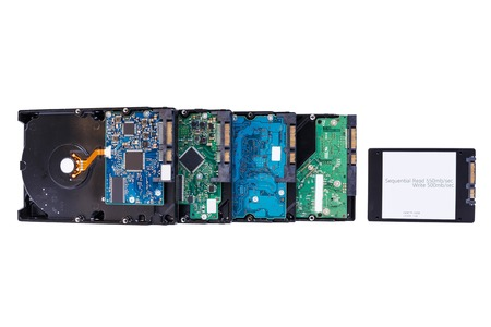 ssd: four Hard disk drives, HDD and SSD on white Stock Photo