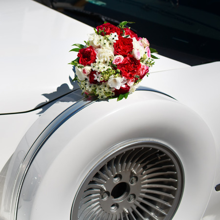 Bridal bouquet on wedding limo.