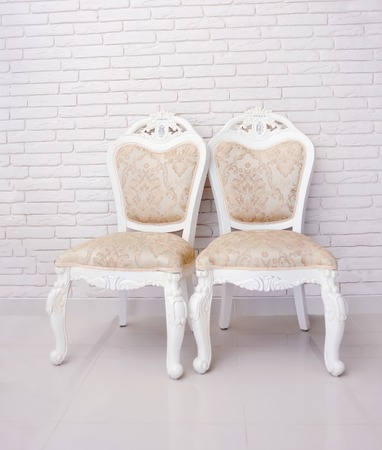 two chairs: Two chairs against break wall Stock Photo