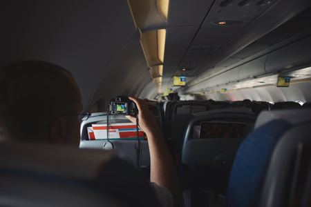 capturing: Aircraft interior. Capturing video Inside the airplane Stock Photo
