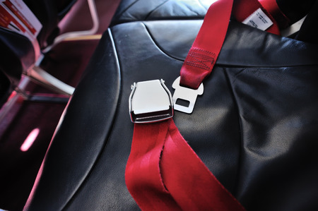 red seat belt in aircraft, airplane flight