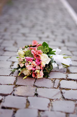 bridal bouquet on a stone background, wedding accessory Stock Photo