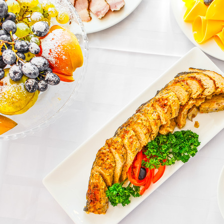 Banquet Table with salmon and olives in restaurant served with different meals. Ready for wedding reception.