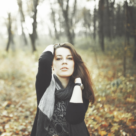 seduce: Natural portrait of young woman in park
