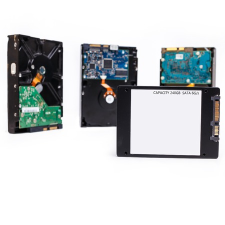 diskdrive: four Hard disk drives, HDD and SSD on white Stock Photo