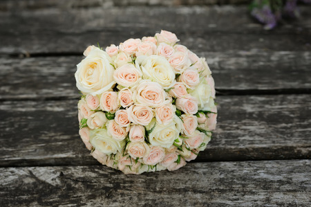 bridal bouquet on wooden background, wedding accessory Stock Photo