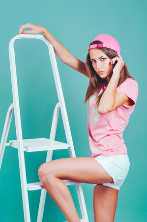 young model with the stepladder in studio