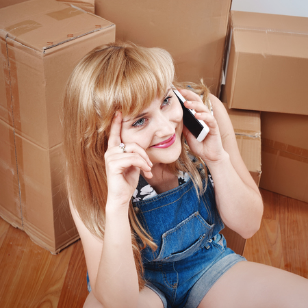 girl moving into new apartment, unpacked furniture